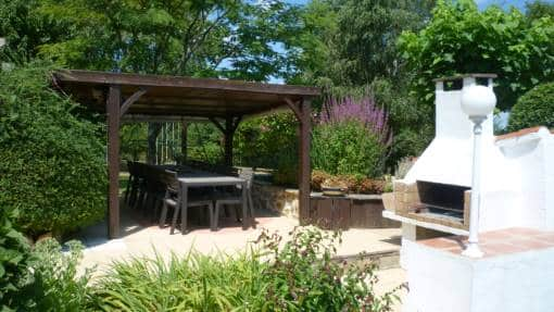 Outside dining and BBQ area beside the pond. gallery of photographs of la petite guyonniere.